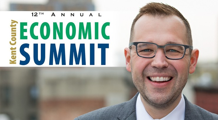 Keynote speaker Steven Pedigo with the logo of the summit superimposed over part of the image