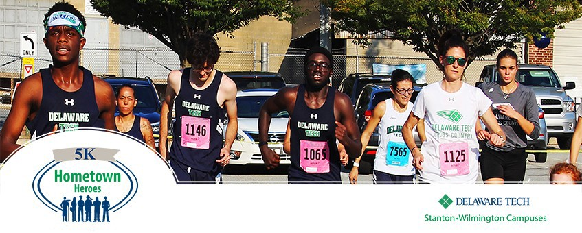 A group of runners with the Hometown Heroes logo superimposed on the bottom left