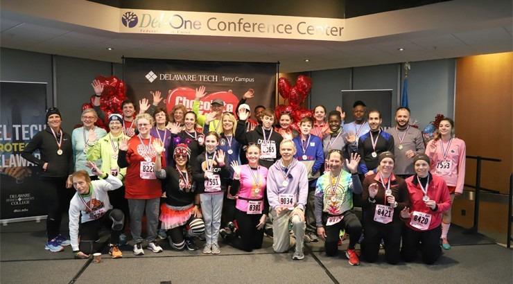 5K Winners grouped together in the Del One Conference Center