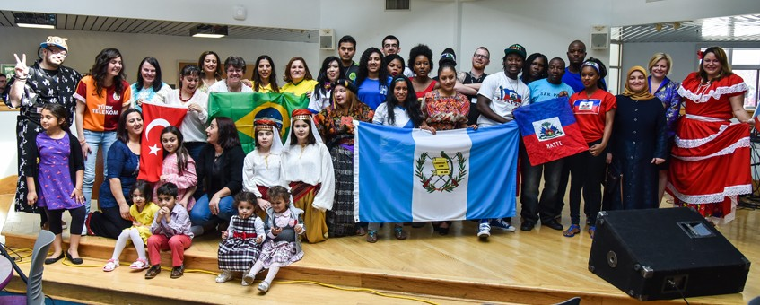 A large group of multi-cultural students and staff at Delaware Tech