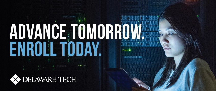 "A woman in a server room with her face illuminated and the words ""Advance Tomorrow Enroll Today"" superimposed over the image"