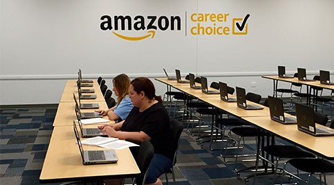 Alicia Nichols and Lida Parag work at laptops in Amazon's dedicated classroom