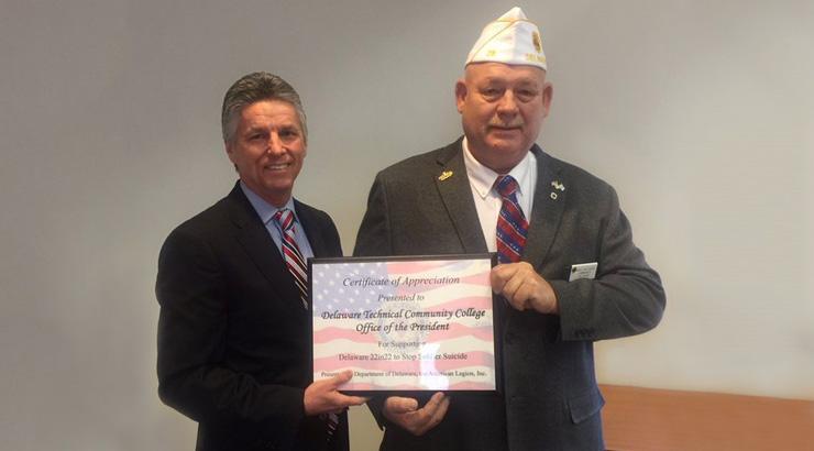 President Mark Brainard and American Legion Commander James Gallagher.