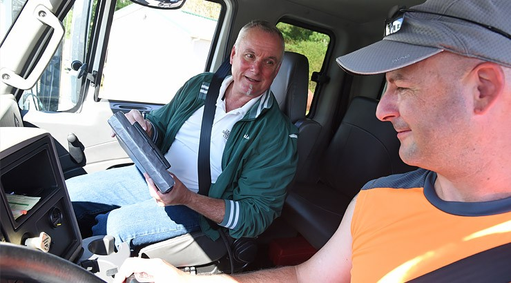 Chris Antonik, left, instructs student Glenn Boyer in the cabin of a tractor trailer prior to taking it out on the practice area at the Delaware Coastal Airport in Georgetown.