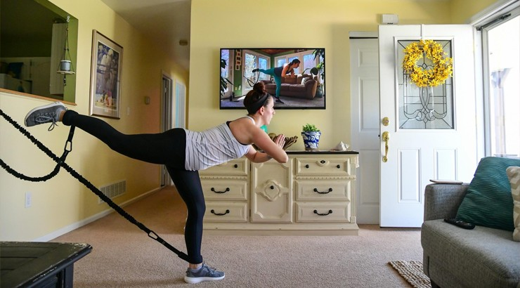 A client of Lovering Studio being led in an at-home workout