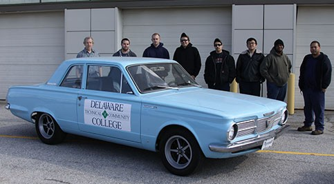 Students and the 1965 Plymouth Valiant