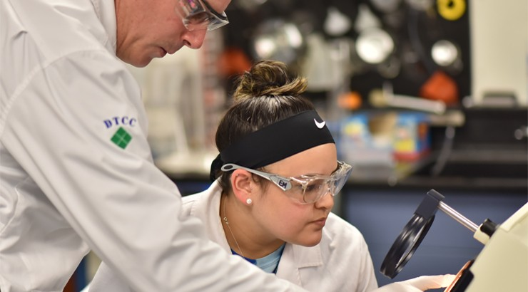 Dr. Michael Buoni works with Ellie McNatt to look closely at one of her samples.