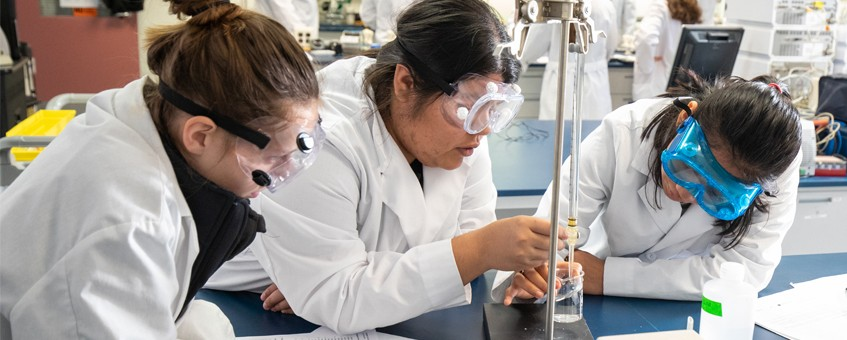 Three Biological Sciences students working in a lab
