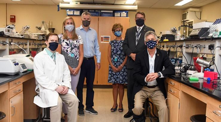 John McDowell, Katie Lakofsky, Michael Fleming, Cheryl Corn, Dan Ehmann, and Mark Brainard in a lab