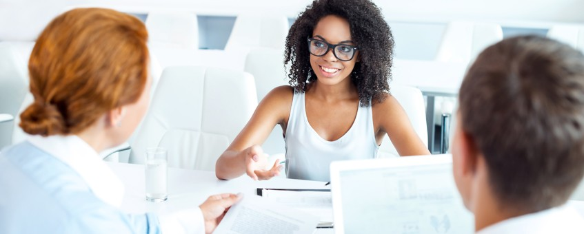 Two employees interviewing a job candidate