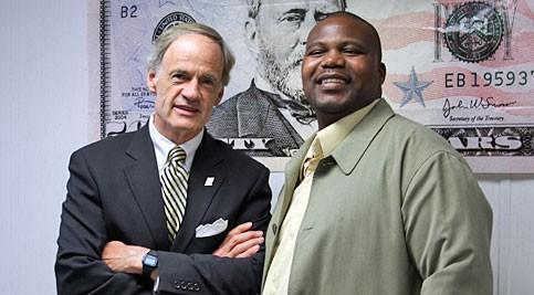 U.S. Senator Tom Carper and faculty