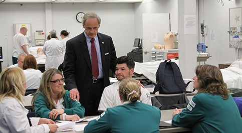 Energy Management Department Chair Mary Marchegiano explains some of the features of the new SETC to Senator Carper. Senator Carper talks to fourth year nursing students during a simulation lab.