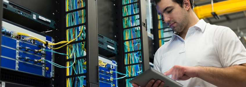 Student workign on network with tablet device in server room