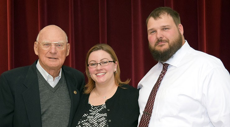 Chabbott (left) stands with nursing program graduate Crystal Vicidomini (center) and her husband, Michael Vicidomini.
