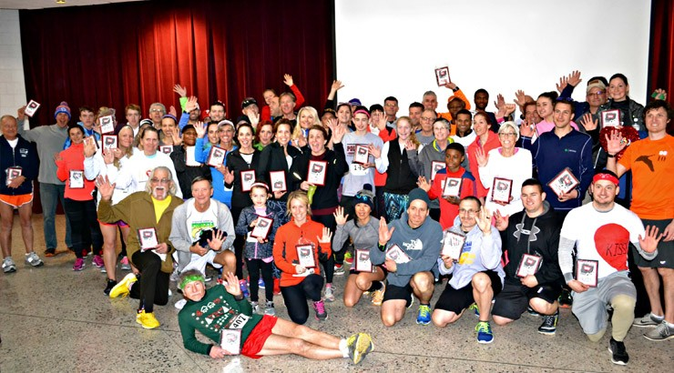 Chocolate 5K winners proudly show off their awards.