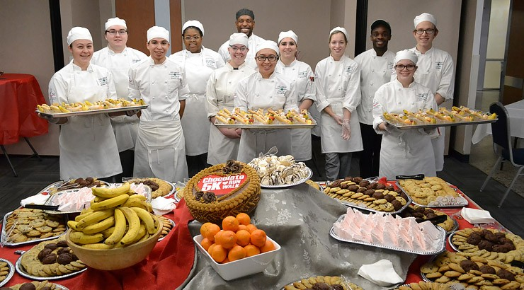 Culinary arts students display some of the tasty treats they prepared for the Chocolate 5K Run/Walk post-race party.