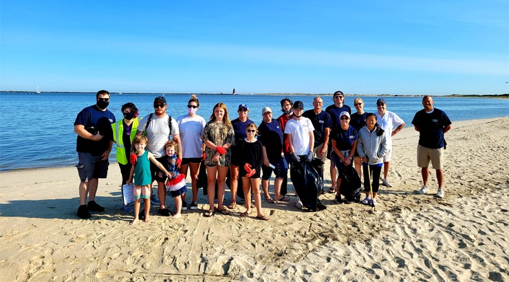 A group of volunteers in masks at Cape Henlopen Beach