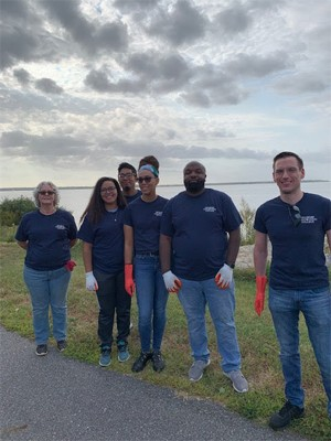 Six Coastal Cleanup volunteers grouped together