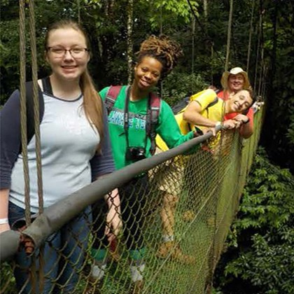Four students on a walking bridge in Costa Rica
