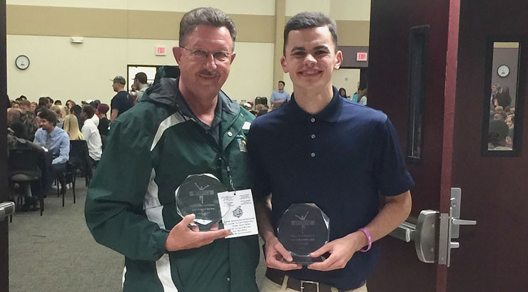 Ray Parker (left) and Mark Corrigan display their Atlantic Region Coach of the Year and Men's Athlete of the Year awards that were presented at the NJCAA Division I National Championship.