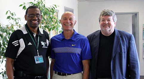 Coach Jim Fischer (center) is welcomed to the school by Stanton/Wilmington Campus Athletic Director Ron Burgess (left) and Assistant Athletic Director Jim Kane (right)