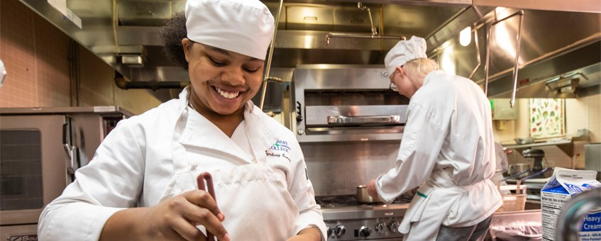 Two Culinary students working in the kitchen