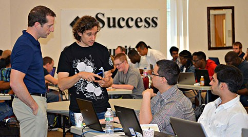 Students discuss plan at Cyber Camp program