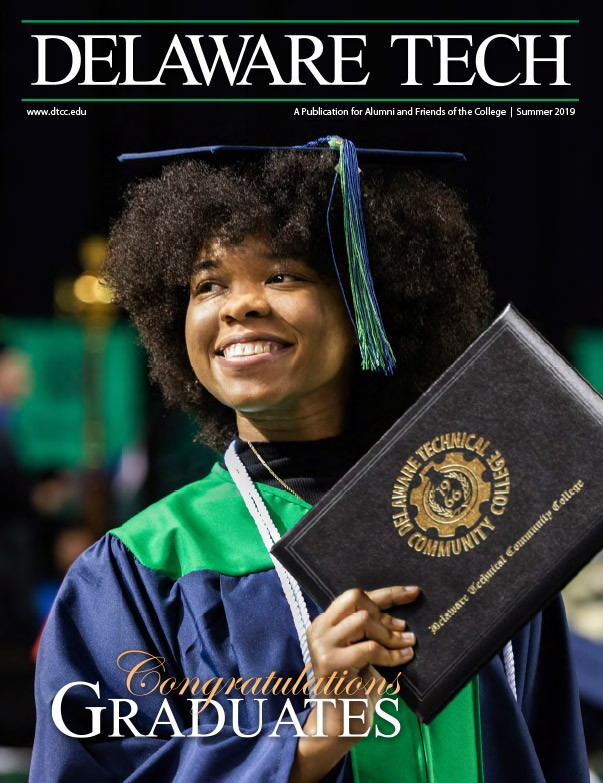 Delaware Tech Magazine Cover of excited graduating female student.