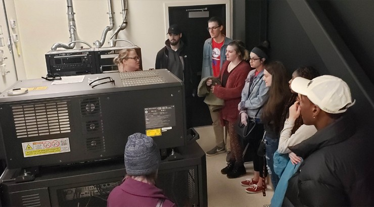 Brooke Lowe explaining the projection process to some Delaware Tech students