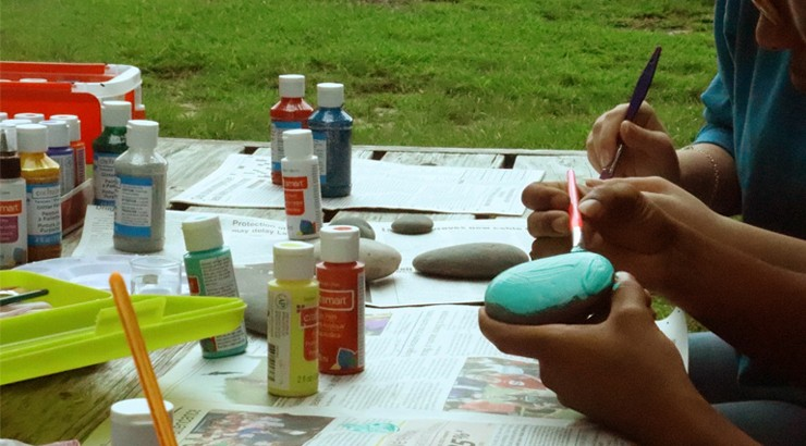 Students painting rocks for the Del Tech Rocks club