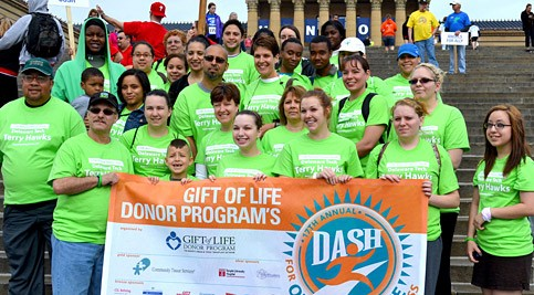 Group participating in the 17th Annual Dash for Organ and Tissue Donor Awareness holding banner
