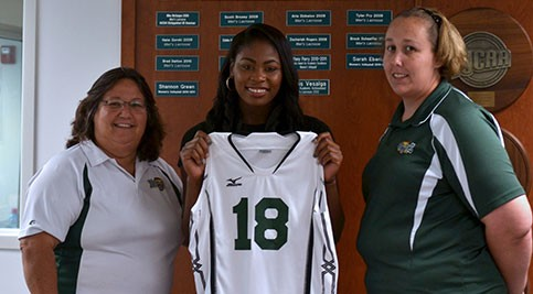 Coach Cindy Savage, Kadijah Doughty, and Athletics Assistant Kristine Ingram.