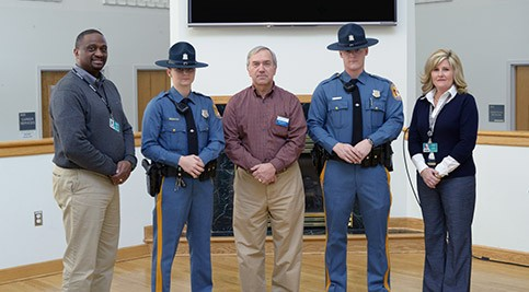 Left to right: Wilbert Bordley, instructor, Recruit Trooper Logan Pavlik, Keith Faulkner, criminal justice department chair and instructor, Recruit Trooper Sean Murray, and Angela Shockley,  instructor.