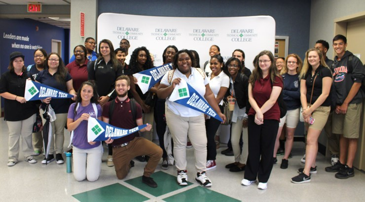 Showing off their Delaware Tech pride, Red Clay Consolidated School District students learn how to get started after enrolling in dual enrollment courses at the George Campus in Wilmington.