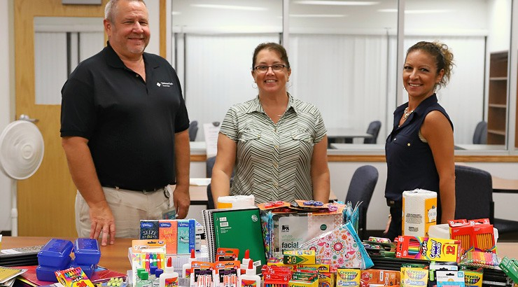 From left, Ray Parsons, Cynthia Larson and Giovanna Thomas, members of the Terry Campus Staff Senate, with items collected during a school supply drive for Star Hill Elementary School.