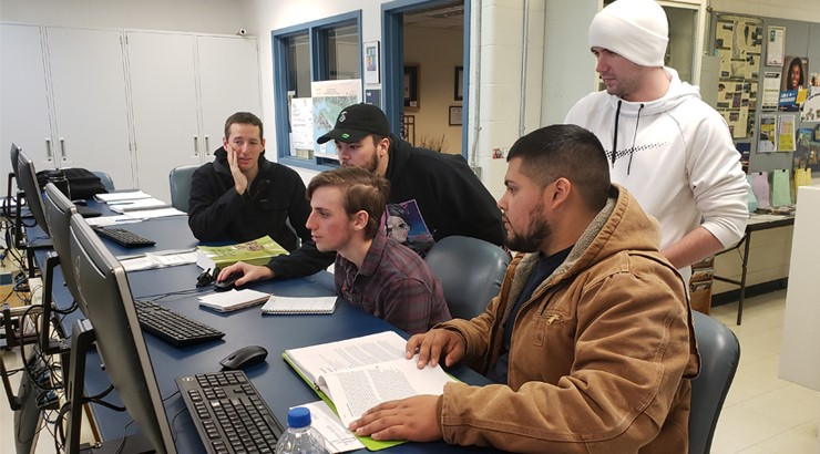 Engineering technology students John Webb, Grant Gano, Colby Kaczka, Ismael Lopez-Estrada, and Connor O'Hagan collaborate on the capstone project during class