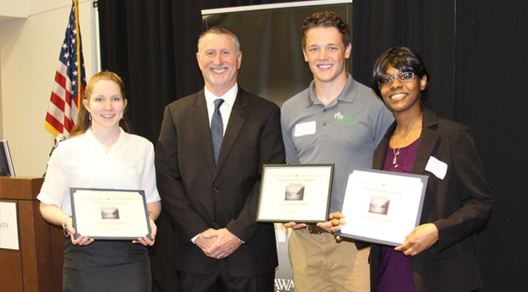 Jordanna Wagner, Nathan Riley, and Latoya Hudnell posing with their awards alongside instructor David Hall