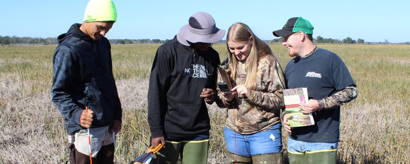 Students record data points in the field.