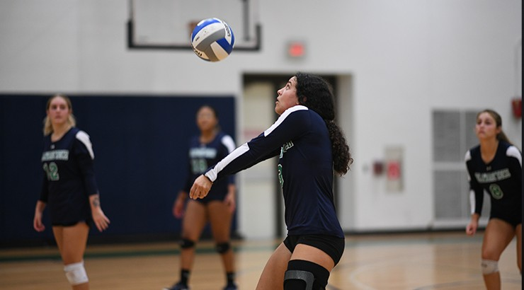 A volleyball player receiving the ball