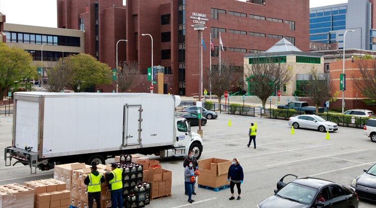 Volunteers distribute food at the Wilmington campus.