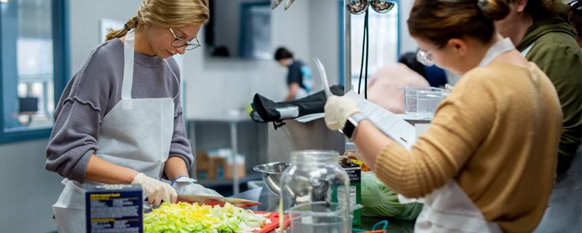 Two students preparing food