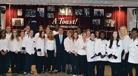 Dr. Orlando J. George, Jr., Delaware Technical Community College president, with Gourmet Gala student volunteers.