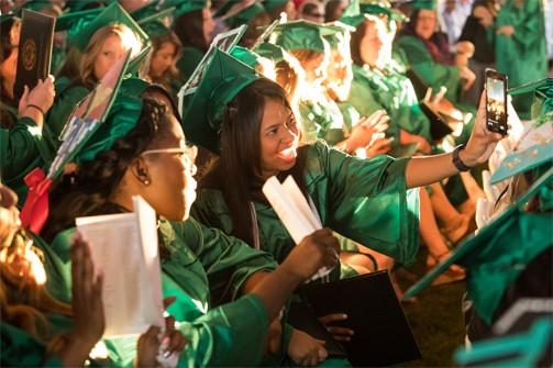 Two graduates taking a selfie