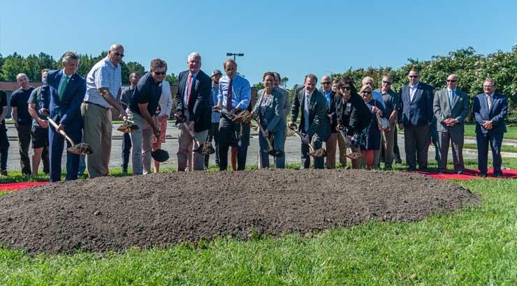 Pictured, from left, Dr. Mark Brainard; Michael Vincent; Charlie Burton; Terry Megee; Sen. Tom Carper; Dr. Bobbi Barends; Dennis Alvord; and Linda Cruz-Carnall.