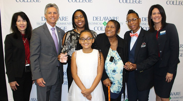 Samanta Lopez posing with her family, President Brainard, and other members of the Delaware Tech staff