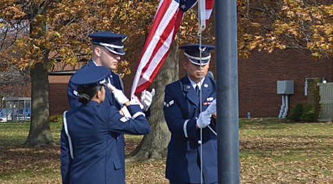 Three veterans lowering flag