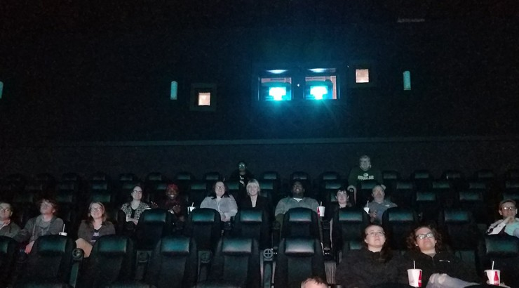 Communications students in an IMAX theater