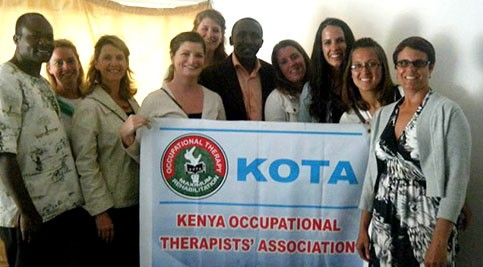 Students and officials holding Kenya Occupational Therapists' Association banner