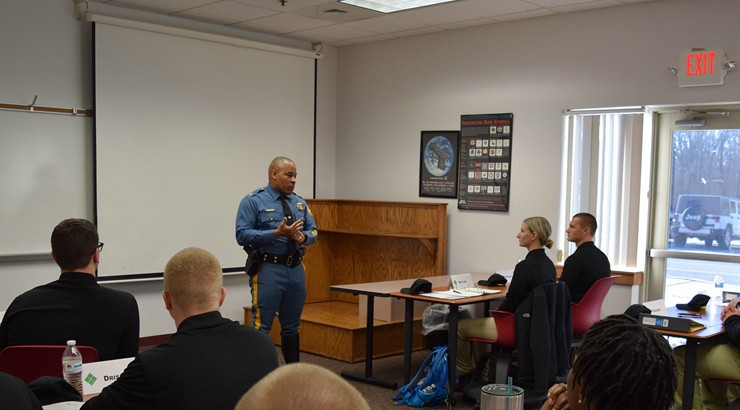 Delaware State Police Superintendent Colonel Nathaniel McQueen Jr. addresses students in the criminal justice law enforcement option (LEO) program