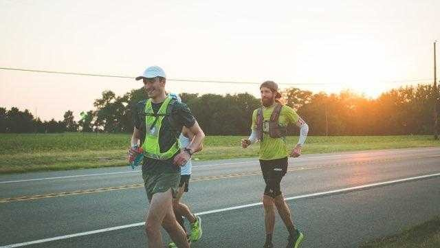 Logan running alongside Mike Wardian